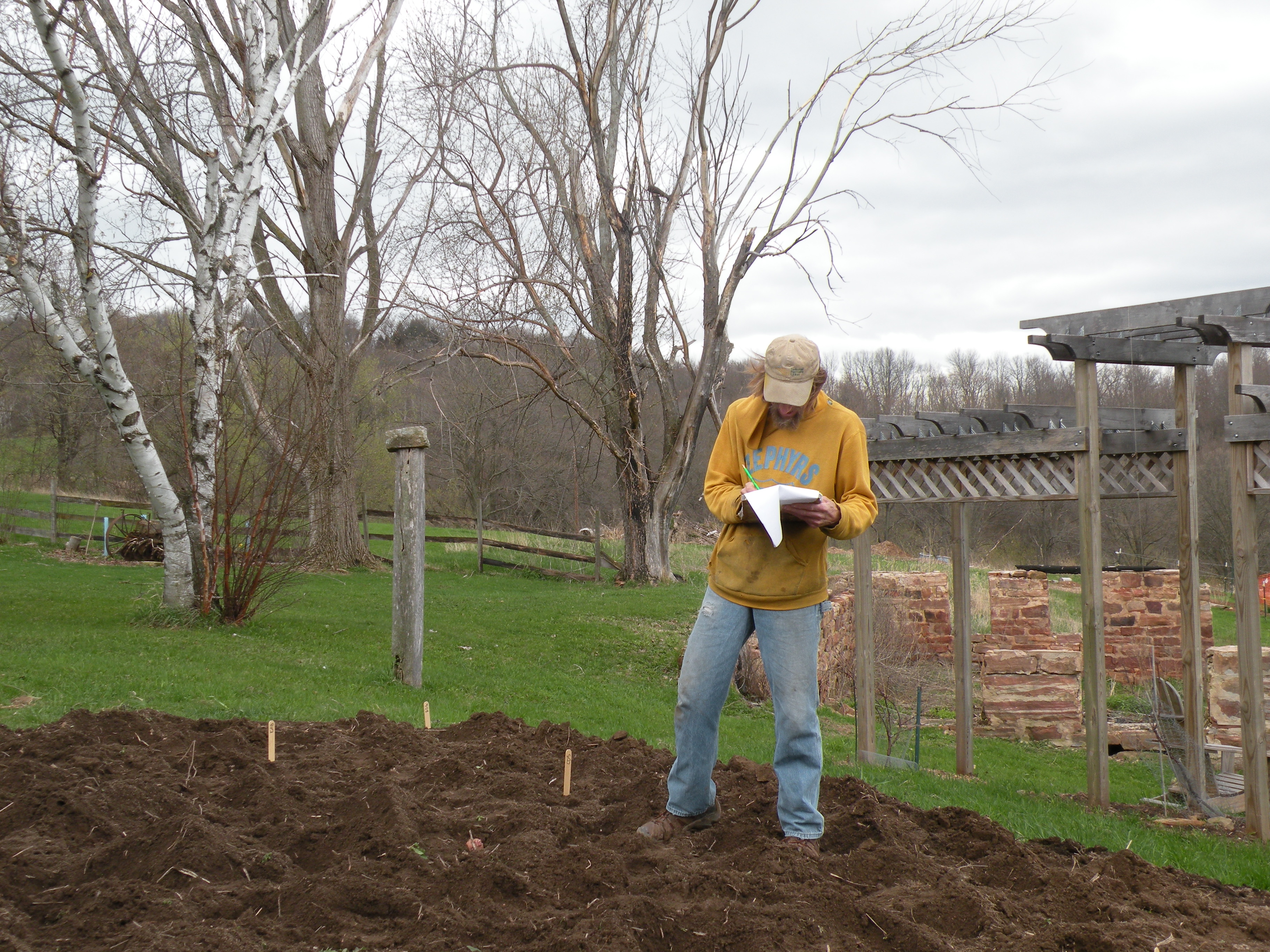 Rob McClure of Hilltop Community Farm, mapping out potato variety trial plantings. Photo by Erin Schneider